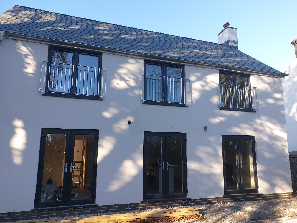 Galvanised safety railings and windows with galvanised gutters and down pipes